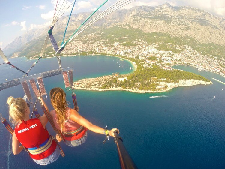 makarska riviera croatia beautiful mountains beaches croatia adventure water sports parasailing