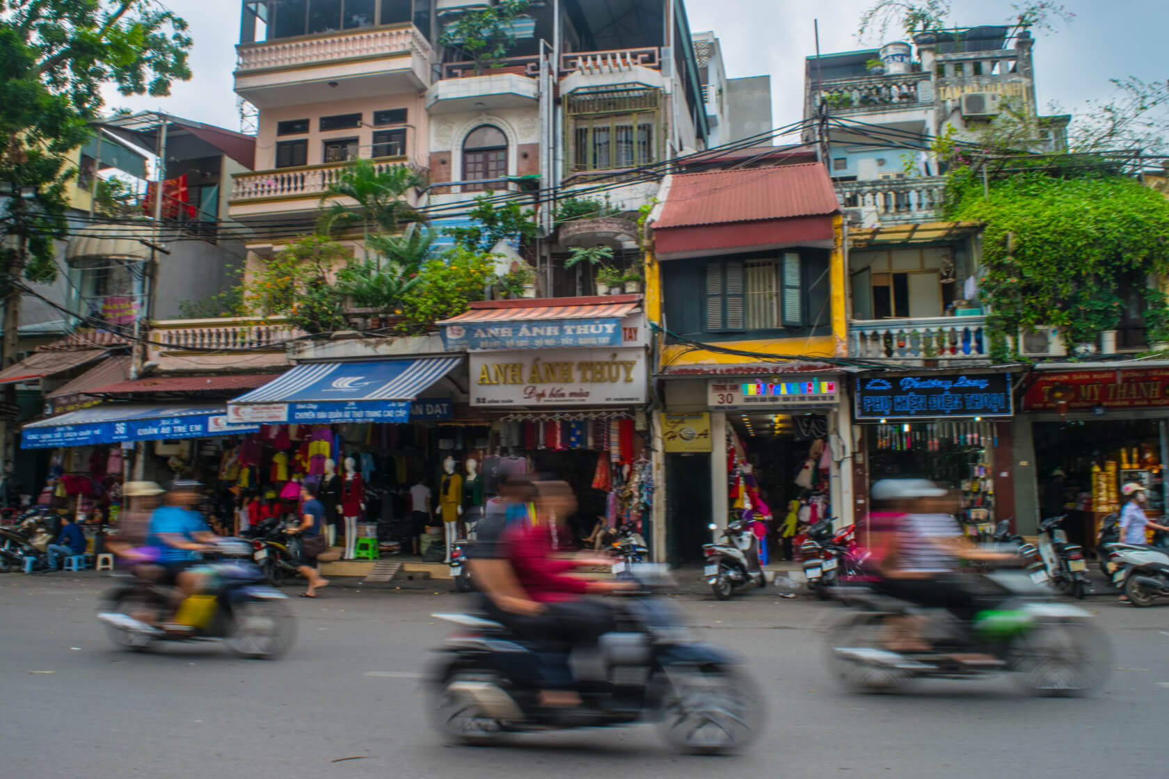 getting visas for vietnam: how not to do it. Scooters going by an a busy hanoi street