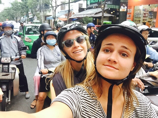 Trying to weave through the dense traffic in Da Nang on our scooter!