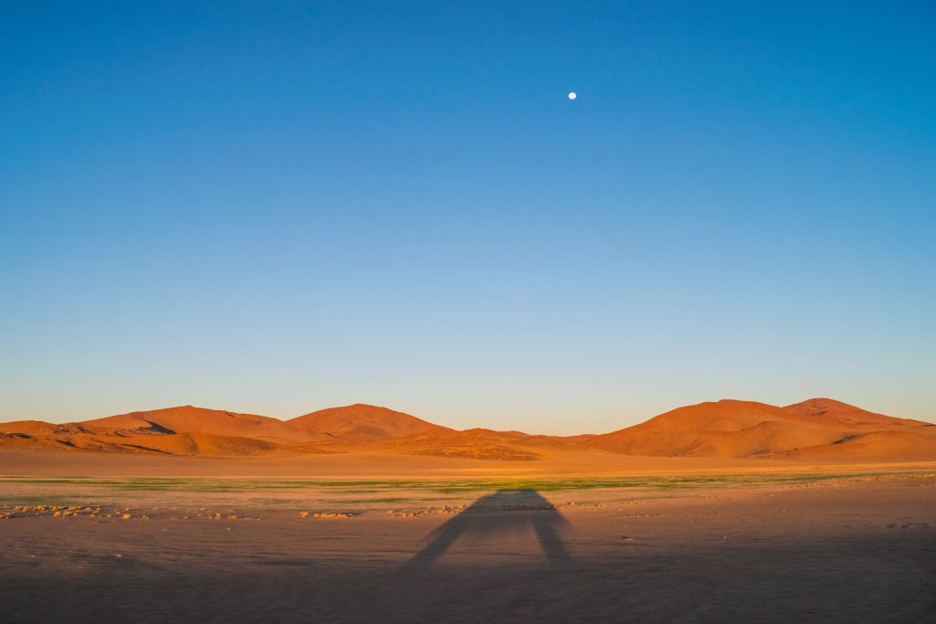 namibian road trip snamib nakluft national park sunrise sand dunes moon