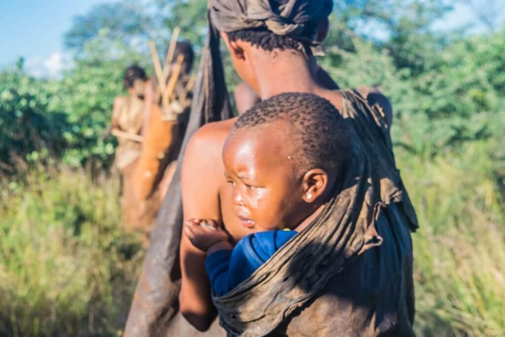 San Bushmen in Botswana walk and dance with the bushmen