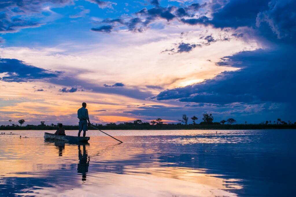 okavango delta safari sunset botswana mokoro boat