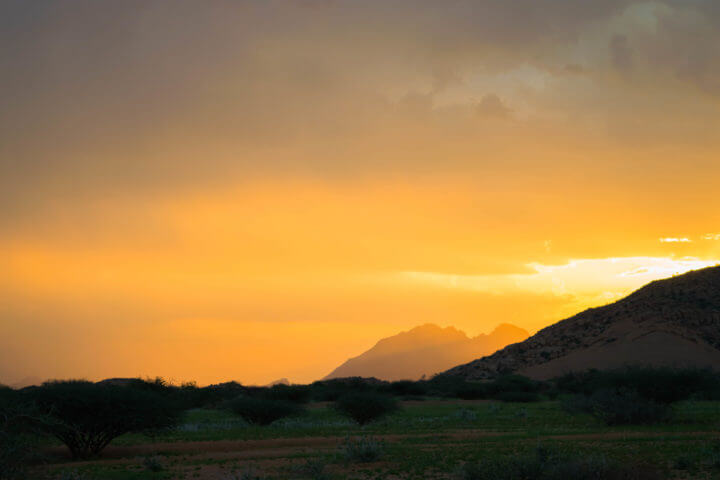 Namibia Road Trip africa spitzkoppe sunset clouds