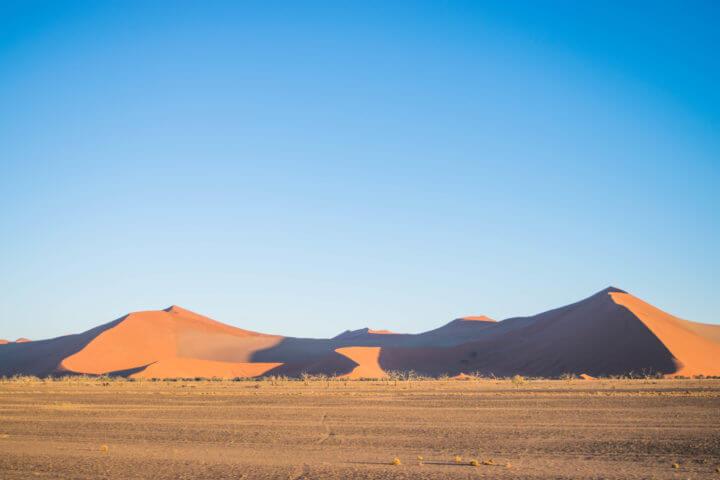 african sunsets over sand dunes in namibia sossusvlei namib desert