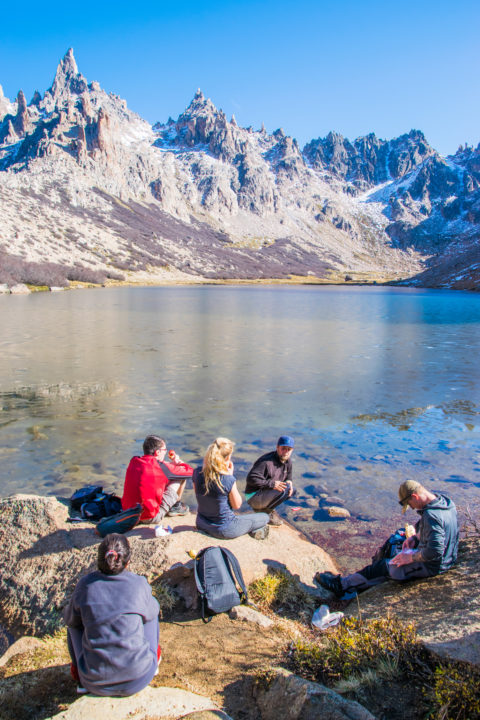 lunch on the lake at the refugio frey hike in bariloche argentina