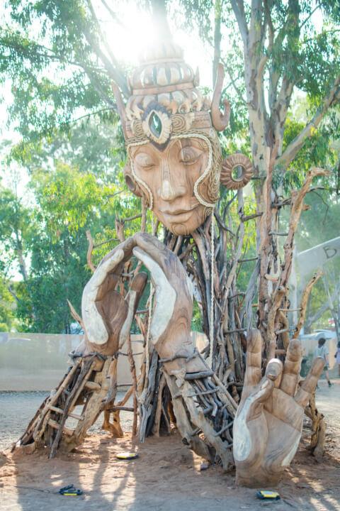 babylon festival art installation wooden buddha