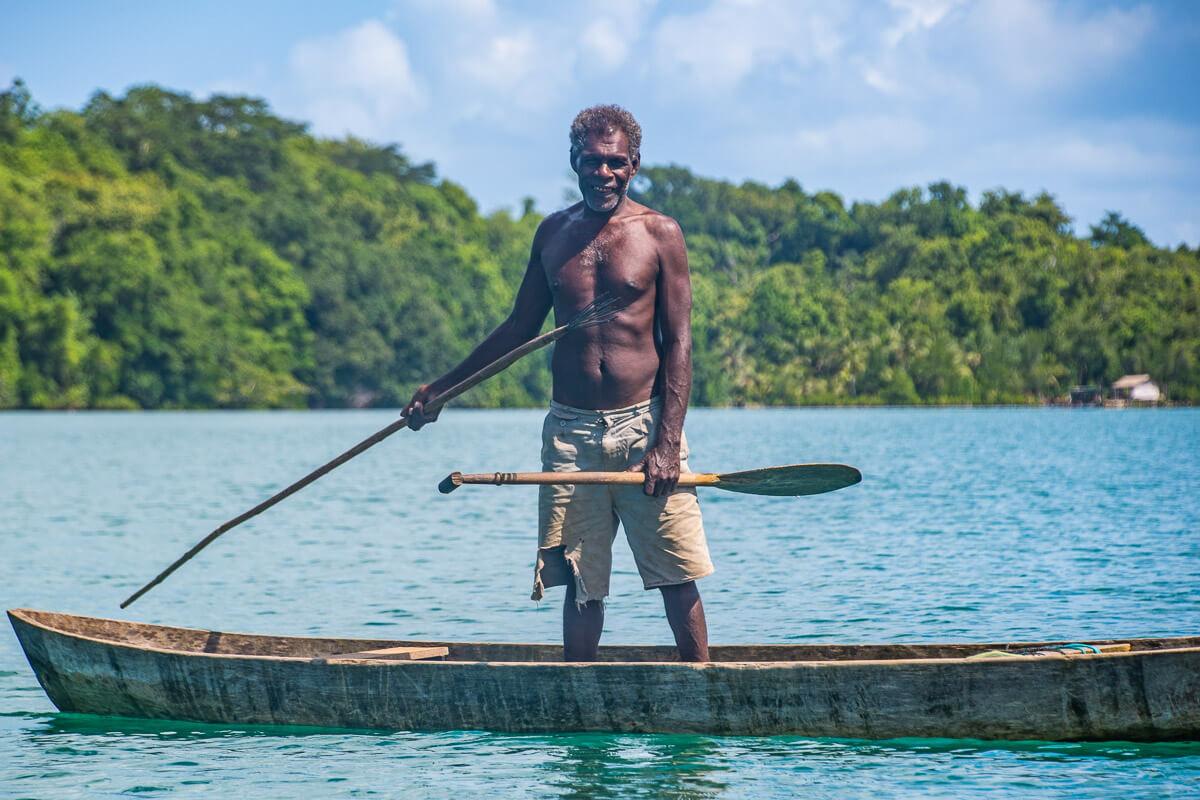 solomon islands fishing local fisherman wooden canoe spearfishing