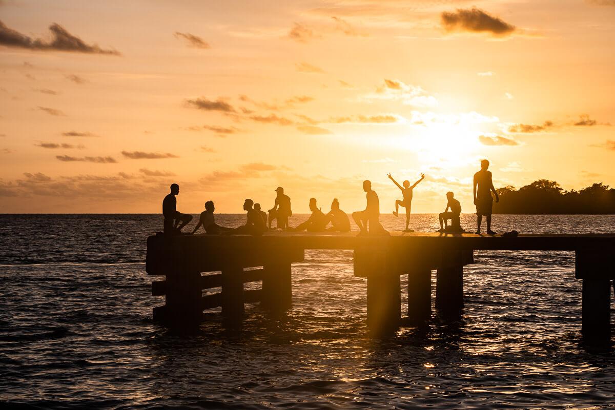 solomon islands sunset locals on the pier solomon islands tourism